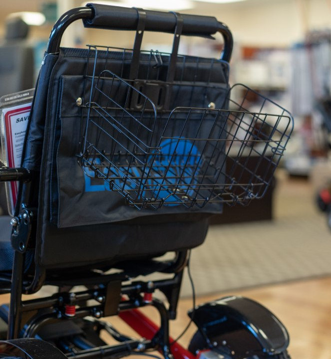 Collapsible Shopping Basket fitted on a easyfold powerchair back side view